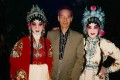 Chan Kwok-yuen with opera performers wearing his headpieces.
