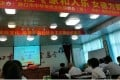 """People study beneath banners in a classroom at a female morality school in southern China's Hunan province. The foreground banner reads: """"For family harmony and happiness, female morality is essential"""". Photo: AP"""