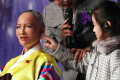 A girl touching the robot Sophia, dressed in the Korean traditional costume, during the Fourth Industrial Revolution and AI Robots exhibition in Seoul. Photo: Yonhap