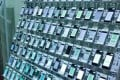 A click farm in Thailand, where scores of mobile phones are strung together to provide digital signatures that mimic the real responses of users. Photo: SCMP/Handout