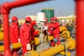 Workers test pipelines at a natural gas storage centre under construction in Henan province. Photo: Reuters