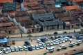 Police cars park outside a village in Lufeng in south Guangdong province during a drug manufacturing bust in 2013. Photo: Xinhua