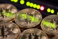 China has announced plans to block all websites related to cryptocurrency trading and initial coin offerings, including foreign platforms. Photo: Bloomberg