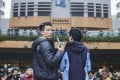 Student union president Lau Tsz-kei (left) and Chinese medicine student Andrew Chan Lok-hang at a protest against Baptist University's decision to suspend Lau and Chan after a stand-off with staff at the language centre. Photo: Winson Wong