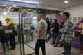 People lining up outside a bitcoin ATM in Hong Kong. Photo: AP