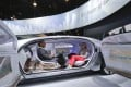 Attendees sit in the self-driving Mercedes-Benz F 015 concept car at the Mercedes-Benz booth at the International CES on Tuesday, January 6, 2015, in Las Vegas. Photo: AP