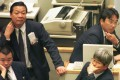 Traders at the Tokyo Stock Exchange in 1997. Photo: AP