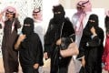 A picture taken on January 19 shows Saudi women and men during the King Abdulaziz Camel Festival in Rumah, some 160km east of Riyadh. Photo: AFP