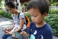 """Mobile devices have become """"essentials"""" for children nowadays. Photo: Edward Wong"""