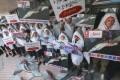 WildAid activists outside Maxim's restaurant at the University of Hong Kong in Pok Fu Lam. Photo: Edward Wong