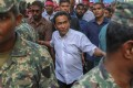 Maldivian President Yameen Abdul Gayoom, surrounded by his bodyguards. Photo: AP