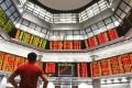 A private stock market gallery in Kuala Lumpur, Malaysia. Photo: AP