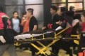 A victim of the knife attack at a shopping centre in Beijing is taken away by paramedics. Photo: Weibo