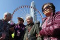 (Left to right) Chiu Wai-chan, Choi Sau-ming, Chow Fuk-far, and Li Au-ying get ready for a ride at the Observation Wheel in Central in December. Social relationships are important to keep us mentally healthy. Photo: Xiaomei Chen