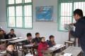 A volunteer teacher is teaching at an elementary school in Guzhang county of Hunan. Photo: Handout