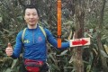 Pan Shancu stops for a photograph during his mammoth run across eastern China last week. The massage shop owner completed the equivalent of five marathons in less than 27 hours. Photo: Sohu.com
