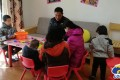 Foster parents Du Jianfeng and Jiao Zhiping have helped to raise 18 orphans with special needs over the past 10 years. Photo: Xw.qq.com