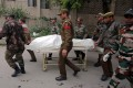 Indian army soldiers carry the body of a colleague who was killed in an attack on an army camp, on a stretcher outside a hospital in Jammu on Sunday. Photo: Reuters