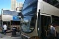 Kowloon Bus Company will temporarily ground 300 part-time drivers from its pool of 8,300 drivers. It says this will not have a major impact on bus schedules. Photo: Robert Ng