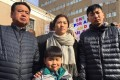 Huang Zhelong (far left) and his wife Li Xiangjin with their two sons. Photo: Weibo.