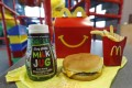 A Happy Meal featuring non-fat chocolate milk and a cheeseburger with fries. File photo: AP