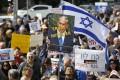 Demonstrators gathered in Tel Aviv on Friday demanding that Prime Minister Benjamin Netanyahu step down over bribery allegations put forward by the Israeli police force. Photo: EPA