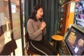 Jodie Zhou sings a song at a mini Karaoke box in a shopping centre in Beijing. Photo: Simon Song