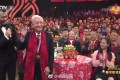 """A former lawyer has been attacked by China's state media and the public after criticising Huang Xuhua (pictured waving) after the 93-year-old """"father of nuclear submarines"""" appeared on a Lunar New Year gala show. Photo: QQ.com"""