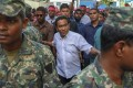 The Maldives president has called for an extension of the country's state of emergency amid political turmoil. Pictured: President Abdulla Yameen on February 3, surrounded by bodyguards. File photo: AP