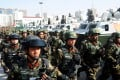 Paramilitary police take part in a counterterrorism rally, in Kashgar, Xinjiang. Photo: Reuters