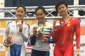 Hong Kong's Sarah Lee (centre) stands proudly on the podium after collecting her third gold in Malaysia. Photos: Handout