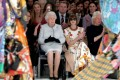 Britain's Queen Elizabeth II sits next to 'Vogue' Editor-in-Chief Anna Wintour (second from right), Caroline Rush (left), chief executive of the British Fashion Council, and royal dressmaker Angela Kelly (far right) as they view Richard Quinn's runway show before presenting him with the inaugural Queen Elizabeth II Award for British Design during London Fashion Week on Tuesday. Photo: Pool via Reuters