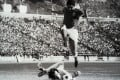 Chow Chee Keong saves from legendary Portuguese Eusebio while playing for an Overseas XI against Benfica at Hong Kong Stadium in February 1973.