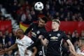 Manchester United's Chris Smalling and youngster Scott McTominay challenge with Sevilla's Steven N'Zonzi during the Champions League last-16 match. Photo: Reuters
