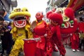 Dong Ky villagers perform a lion dance on the fourth day of Tet, or the Vietnamese Lunar New Year, in Dong Ky, Bac Ninh province, Vietnam. Picture: Luong Thai Linh