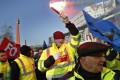 Air France employees demonstrate outside the French airline's headquarters in Roissy, north of Paris. Employees of the flag carrier are calling for more pay. Photo: AP