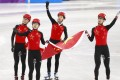 Olympic silver medallists Wu Dajing (right) Han Tianyu (second left) Chen Dequan (left) and Xu Hongzhi (second right) of China react after the short track speedskating 5,000m relay final. Photo: EPA