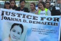 Relatives of Filipina worker Joanna Demafelis hold banners as they wait for the arrival of her body from Manila at Iloilo International Airport, central Philippines, on February 17, 2018. Photo: AFP