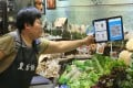 A merchant with a QR code payment system at a stall inside Po Tat Market in Sau Mau Ping. Photo: Edmond So