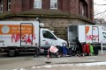 Vandalised vehicles delivering food at the Tafel in Essen, Germany. Photo: EPA