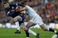Scotland's Finn Russell is tackled by England's Owen Farrell. Photo: Reuters