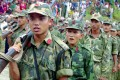 Young Nepalese Maoist rebels take part in a ceremony in May, 2001. Photo: Reuters