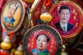 Souvenirs with portraits of President Xi Jinping and Mao Zedong displayed at a shop in Beijing. Photo: EPA-EFE