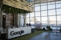 Signage is displayed on a reception desk at Google's scenic new campus in Boulder, Colorado. Photo: Bloomberg