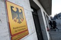 """Two men enter a building that is part of the German Federal Ministry of Defence in Berlin on Wednesday. German media reports said both the Ministries for Defence and Foreign Affairs were breached by the Russian hacker group known as APT28 or """"Fancy Bear"""". Photo: EPA"""