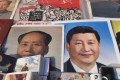 Posters of Mao and Xi Jinping at a market in Beijing. Photo: AFP