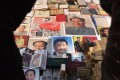 Posters of Chinese President Xi Jinping and Mao Zedong in Beijing. Photo: AFP