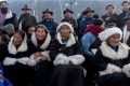 People celebrate the Tibetan New Year in the village of Shuangpengxi on the Qinghai-Tibet Plateau. A delegate to China's top political advisory body has urged central authorities to stop discriminating against ethnic groups. Photo: AFP