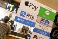 A signboard showing Apple Pay, Alipay and WeChat Pay is seen at a store in Guangzhou, in the southern Chinese province of Guangdong. WeChat Pay was rated the best mobile payment app in a customer survey in Hong Kong. Photo: Handout