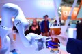 A robot made by Kuka serves beer at the Hanover Fair last April. Midea paid US$5 billion to take over Kuka in 2016. Photo: AFP
